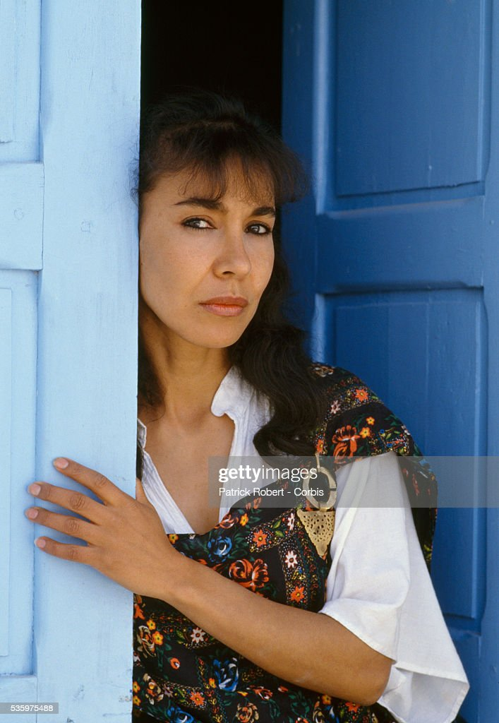 Tunisian actress Nadia Samir stands in a doorway on the set of the film Coeur Nomade. The film was directed by Tunisian director Fitouri Belhiba. 1990