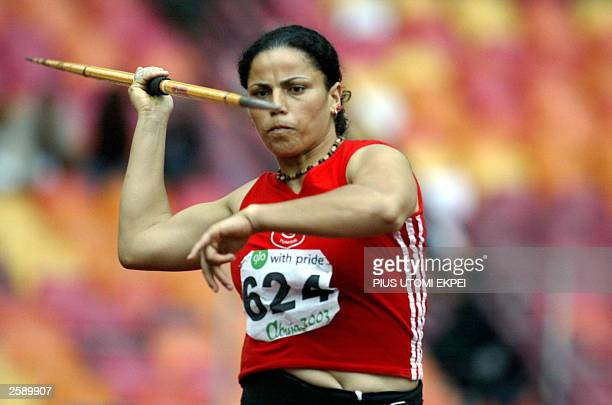 Tunisian Aida Sellem throws the javelin 13 October 2003 to win gold medal in the womens javelin at the 8th All African Games in Abuja AFP PHOTO/PIUS...