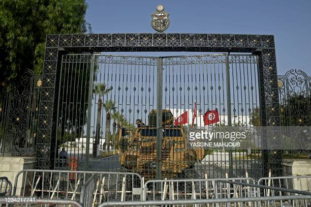 Tunisian army barricade the parliament building in the capital Tunis on July 26 after the president dismissed the prime minister and ordered...