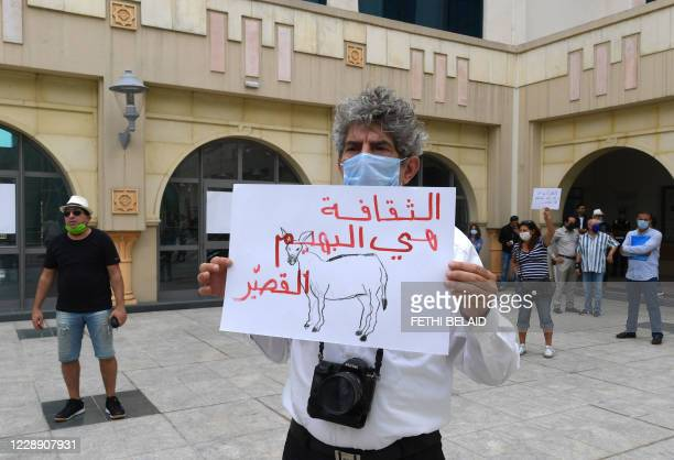Tunisian artists and cultural workers observe a sit-in in front the opera theatre on October 5, 2020 in the capital Tunis amid the Covid-19...