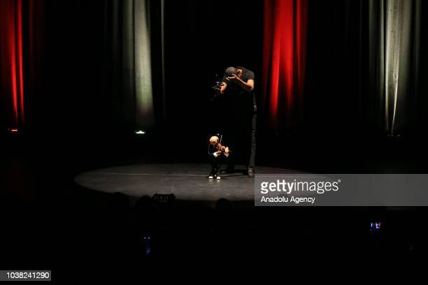 Tunisian artists perform a puppet show during the opening of 'Carthage Days of Puppetry Arts' which will be held from 22 to 29 September with the...