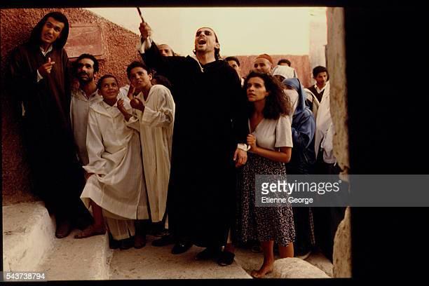 Tunisian born Actress Amina Annabi and Panamanian actor Miguel Bosé on the set of 'La Nuit sacrée' directed by Nicolas Klotz based on the Tahar Ben...
