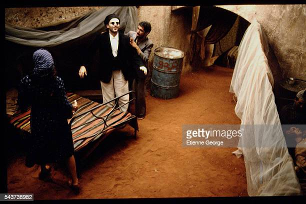 Tunisian born Actress Amina Annabi and Panamanian actor Miguel Bos on the set of 'La Nuit sacre' directed by Nicolas Klotz based on the Tahar Ben...