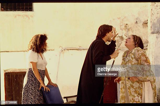 Tunisian born Actress Amina Annabi and Panamanian actor Miguel Bos and X on the set of 'La Nuit sacre' directed by Nicolas Klotz based on the Tahar...