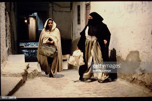 Tunisian born Actress Amina Annabi and X on the set of 'La Nuit sacrée' directed by Nicolas Klotz based on the Tahar Ben Jelloun novel of the same...