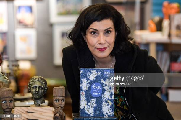 """Tunisian cartoonist Nadia Khiari, creator of the """"Willis from Tunis"""" cartoon cat series, poses with her latest Willis book published in November..."""