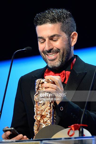 Tunisian cinematographer Sofian El Fani holds his trophy after winning the Best Cinematography award for Timbuktu during the 40th edition of the...