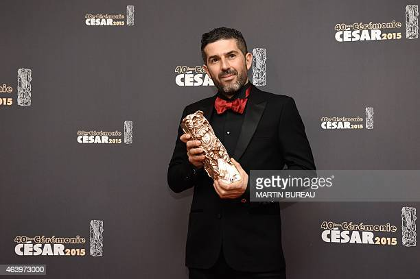 Tunisian cinematographer Sofian El Fani poses with his trophy during a photocall after winning the Best Cinematography award for Timbuktu during the...