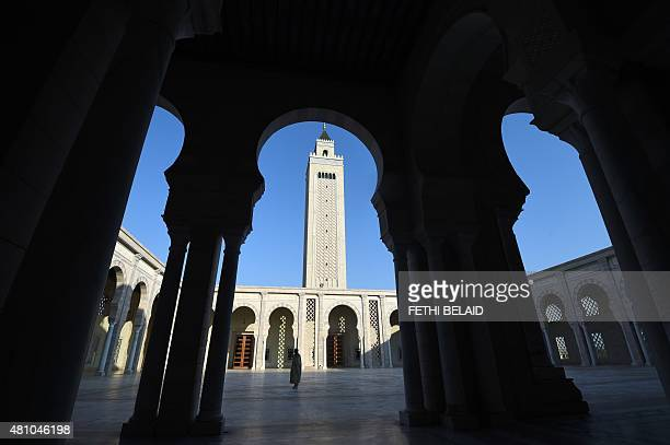 A Tunisian cleric walks in the courtyard of Carthage's Malik ibn Anas mosque also known as ElAbidine mosque on the outskirts of the capital Tunis on...