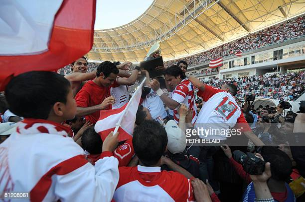 Tunisian Club Africain players celebrate the 'Trophe' the Major league Tunisian Championship at Rades Olympic stadium on May 22 2008 after beating E...