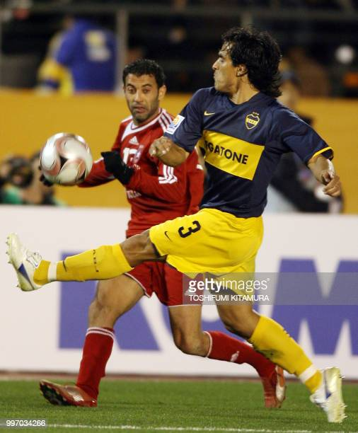 Tunisian club team Etoile Sahel defender Sabeur Frej controls the ball as Argentina club team Boca Juniors defender Claudio Morel attempts to block...