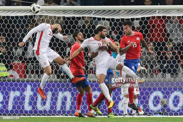 Tunisian defender Dylan Bronn heads the ball during the international friendly football match between Tunisia vs Costa Rica on March 27 2018 at the...