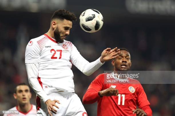 Tunisian defender Dylan Bronn vies with Costa Rica's Josue Mitchell during the international friendly football match between Tunisia vs Costa Rica on...