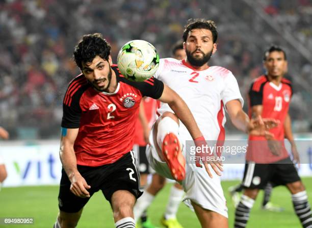 Tunisian defender Syam Ben Youssef vies for the ball against Egyptian defender Aly Gabr Mosaab during their African Cup of Nations CAN 2019...