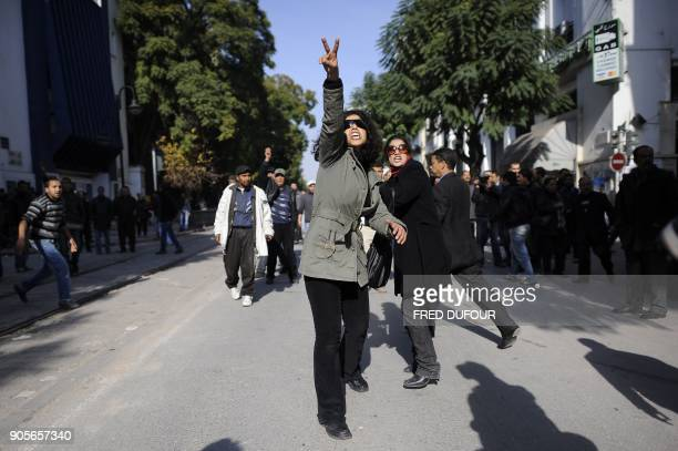 A Tunisian demonstrator makes the Vsign during clashes with police forces after a protest in central Tunis on January 17 2011 Tunisian protesters...