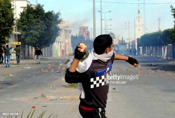 A Tunisian demonstrator prepares to throw a rock during clashes with security forces in Regueb near Sidi Bouzid on January 10 2011 Tunisian President...