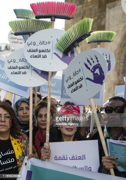 Tunisian demonstrators carry banners during a march against violence towards women in Tunis, Tunisia on November 30, 2019.