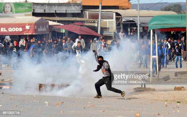 Tunisian demonstrators clash with security forces in the northern town of Sejenane on December 12 2017 after the town's police station was reportedly...