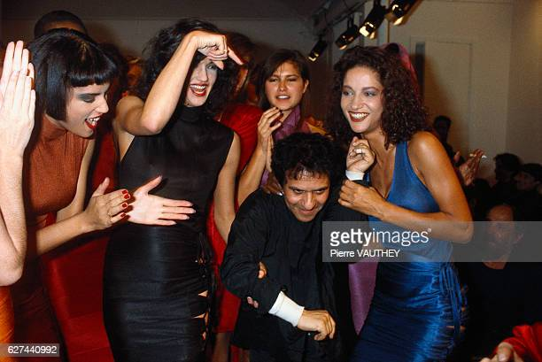 Tunisian designer Azzedine Alaia is surrounded by his models at his 1986 springsummer women's fashion show in Paris