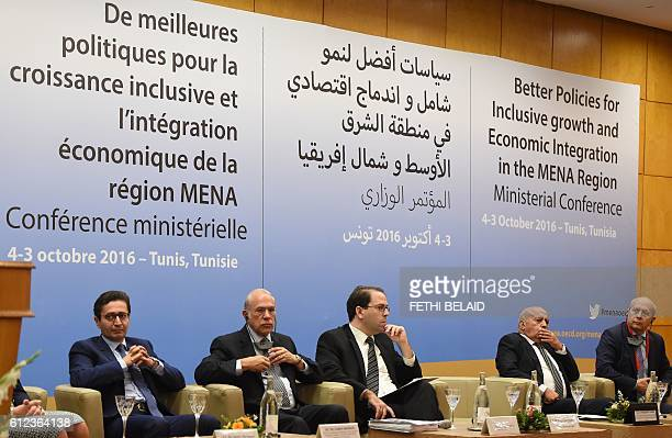 Tunisian development and investment minister Fadhel Abdelkefi the General Secretary of the Organisation for Economic Cooperation and Development Jose...