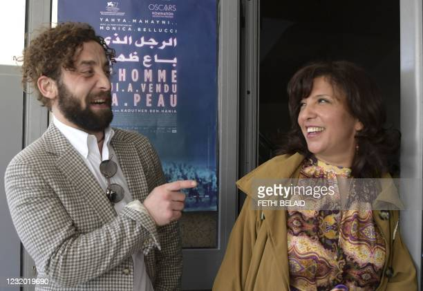 """Tunisian director and screenwriter Kaouther Ben Henia and Syrian actor Yahya Mahayni attend the first screening of her film """"The man who sold his..."""