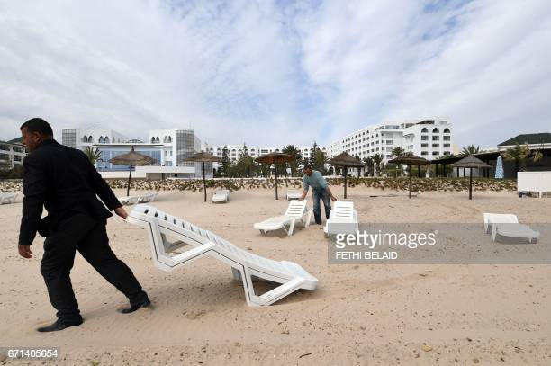 Tunisian employees set up deck chairs on the beach of the Imperial Merhaba Hotel in Port elKantaoui on the outskirts of Sousse south of the capital...