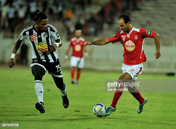 Tunisian ES Sahel striker Zouheir Dhaouadi vies with Congolese TP Mazembe defender Christian Luyindama on September 17 2016 at the Olympic Stadium in...