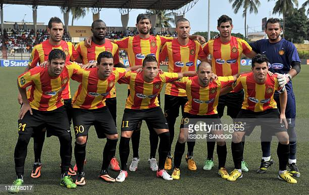Tunisian Esperance de Tunis team's players pose prior to the African Champions league football match Sewe Sport de SanPedro vs Esperance Tunis on...
