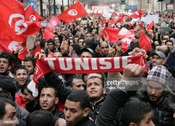 Tunisian expatriates shout slogans while holding Tunisian flags as they demonstrate on January 15, 2011 in Paris, France. Zine al-Abidine Ben Ali,...
