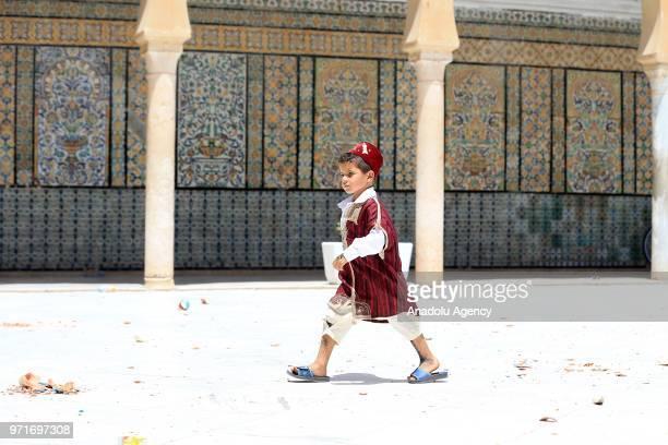 Tunisian families bring their children for annual circumcision feast tradition at Sidi Sahab Zawiya and Madrasa ahead of Laylat al-Qadr in Kairouan,...