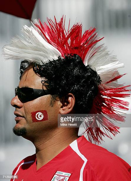 Tunisian fan awaits the kick off of the FIFA World Cup Germany 2006 Group H match between Tunisia and Saudi Arabia at the Stadium Munich on June 14...