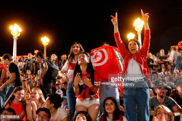 Tunisian fans celebrate their team's equalizer as they watch the Russia 2018 World Cup Group G football match between Tunisia and England at the...