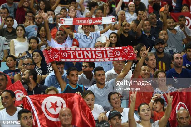 Tunisian fans react during the World Cup 2018 Africa qualifying football match between Tunisia and DR Congo at the Stade Olympique in Rades on...