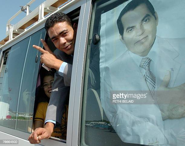 Tunisian fisherman Hamza Brahim flashes the V-sign for victory upon his arrival 11 September 2008 at the Tunis-Carthage airport after being released...