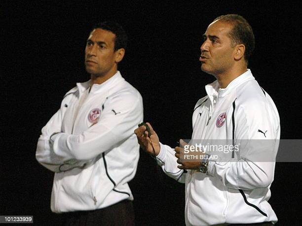 Tunisian football national team's coach Sami Trabelsi speaks beside his assistant Ali Boumnijel during a training session on May 28 2010 in Rades...