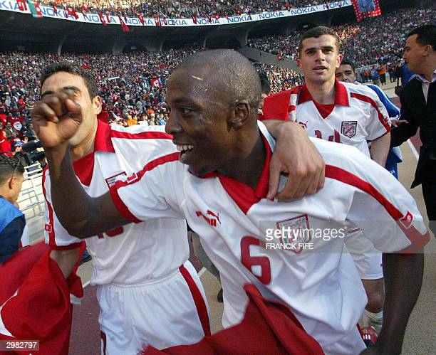 tunisian-football-player-hatem-trabelsi-celebrates-his-teams-21-win-picture-id2982797?s=612x612