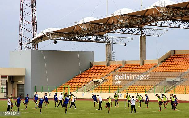 Tunisian football team players warm up during a training session at the Malabo stadium in Guinea on June 15 2012 ahead of their 2014 World Cup...