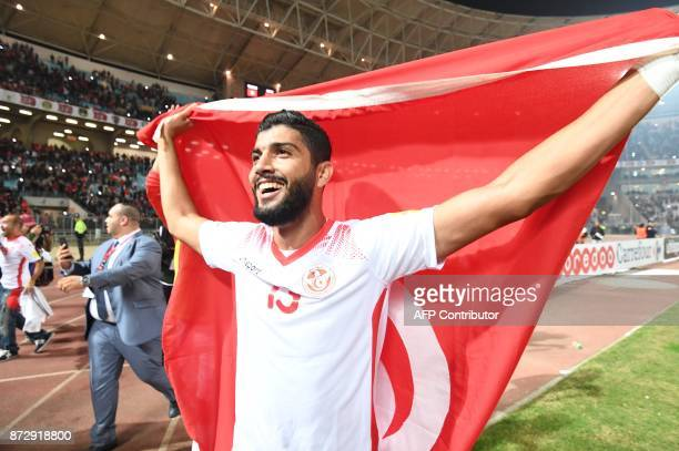 Tunisian footballers Ferjani Sassi celebrates on the pitch after qualifying for the 2018 World Cup finals after drawing their qualifiers match...