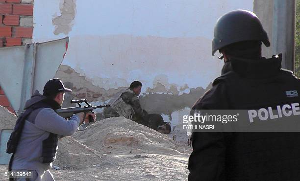 Tunisian forces check the body of a militant killed during clashes in the southern town of Ben Guerdane near the Libyan border on March 7 2016...
