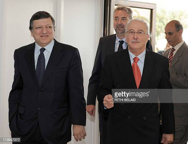 Tunisian Foreign Affairs Minister Mouldi Kefi walks with European Commission President Jose Manuel Barroso on his arrival at the airport on April 12,...