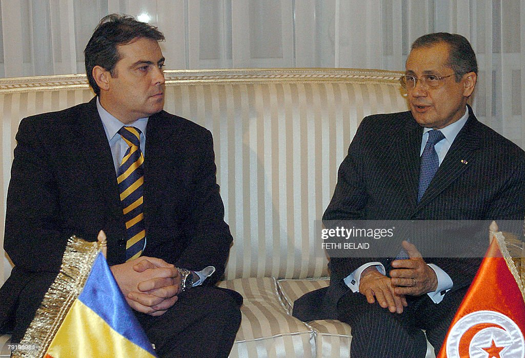 Tunisian Foreign Minister Abdelwahab Abdallah (L) greets Romanian counterpart Adrian Cioroianu (R) 24 January 2008 in Tunis. Cioroianu is on a two-day official visit to Tunisia to discuss political and economic cooperation.