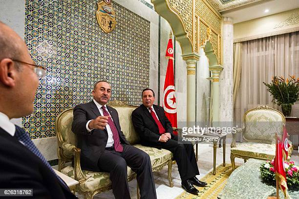 Tunisian Foreign Minister Khamis AlJehinawi and Turkish Foreign Minister Mevlut Cavusoglu are seen during their meeting in the foreign ministry...