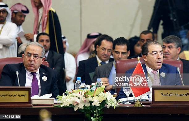 Tunisian Foreign Minister Mongi Hamdi sits near his Algerian counterpart Ramtane Lamamra during the opening session of the Arab League Foreign...