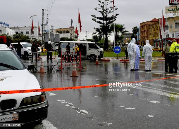 Tunisian forensic police investigate the site of an attack on Tunisian National Guard officers on September 6 in Sousse, south of the capital Tunis....