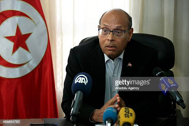 Tunisian former President Moncef Marzouki delivers a speech about the Bardo Museum attack in Tunis Tunisia on March 19 2015