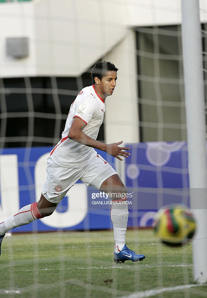 Tunisian Forward Issam Jemaa celebrates, 23 January 2008, as he scores against Senegal during the 2008 African Cup of Nations match between Tunisia and Senegal at Tamale Stadium in Tamale, Ghana.