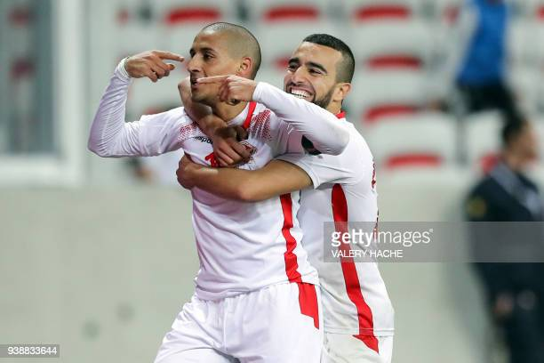 Tunisian forward Wahbi Khazri celebrates after scoring a goal during the friendly football match between Tunisia vs Costa Rica on March 27 2018 at...