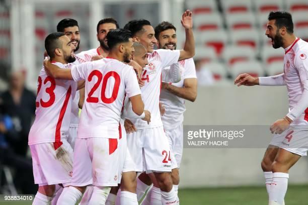 Tunisian forward Wahbi Khazri celebrates with teammates after scoring a goal during the friendly football match between Tunisia vs Costa Rica on...