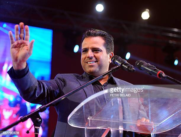 Tunisian founder and president of the Free Patriotic Union Slim Riahi greets his supporters during a campaign meeting in the Mellassine city a poor...