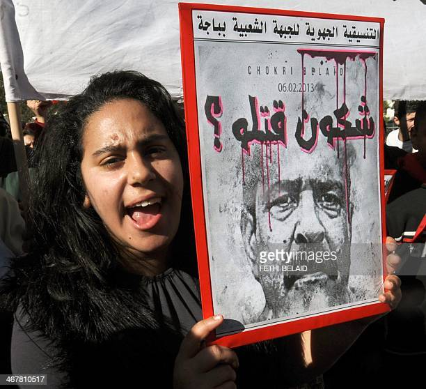 A Tunisian girl holds a placard with a portrait of murdered opposition figure Chokri Belaid outside ElJellaz cemetery in a suburb of Tunis where...